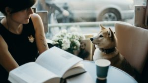 woman having a coffee date with her dog